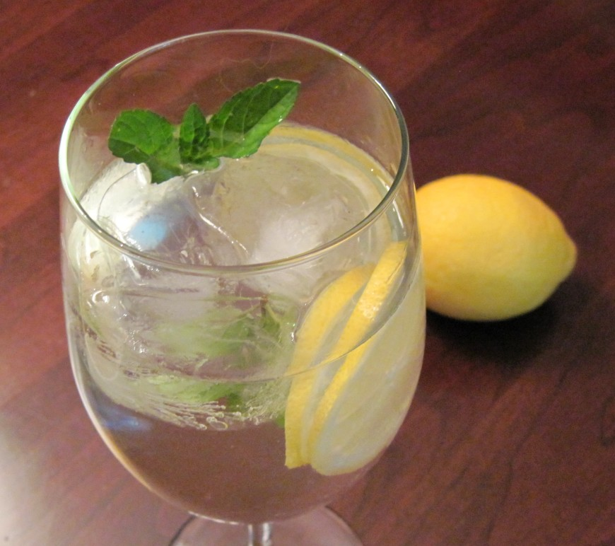 Fresh mint leaves muddled with lemon slices in water make for a refreshing tummy ache tamer.