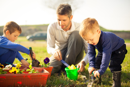 Family gardening is a great way to be active outdoors, and everyone shares in the health benefits of gardening.  Lots of memories being made here. (Photo © sneksy13 – Fotolia.com)