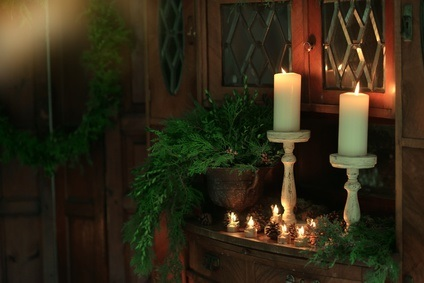 Simple evergreen arrangements in a vase, or around the base of a candle are all it takes to transform any room into a special place to gather for the holidays.